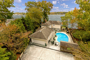 Aerial View W/ River, Pool, 2-car Garage, Shed & Extra Parking Pad