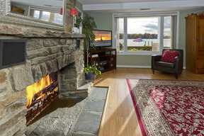 Living Room with Stone Fireplace & Water Views