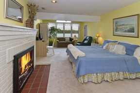 Master Bedroom Suite with Fireplace & Water Views