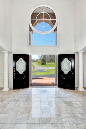 Two Story Foyer & Circle Motif Transom Window