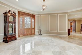 Extended Back Foyer w/ Marble Floors and Rear Door