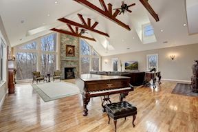Great Room w/ Over-sized Stone Fireplace & Clerestory Windows