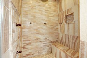 Main Level Shower Clad in Onyx w/Body Sprays, Bench & Niche
