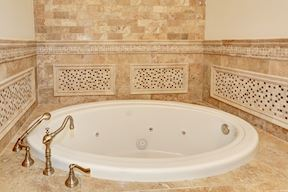 Hall Bath Jetted Tub & Decorative Tile Surround