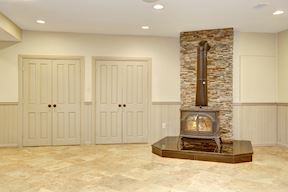Lower Level Wood Burning Stove and Doors to Mechanical Room