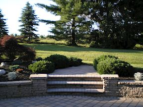 Garden Plantings and Gracious Paver Stair to Spacious Rear Lawn