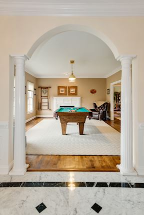 Celebrated Arch Entry to Living Room