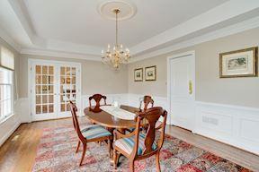 Formal Dining w/ French Doors & Pivot Door to Butler's Service