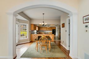 Arched Cased Opening to Breakfast Room w/ Bump-out Doors to Patio & Arched Opening to Great Room