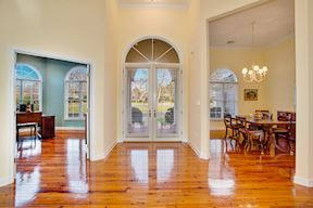 Open Plan w/ Welcoming Foyer Flanked by Formal Dining & Library