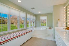 Spa-like Master Bath w/Storage Bench & Generous Double Vanity