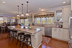 Custom Gourmet Kitchen with Entertainers Island and Breakfast Bar