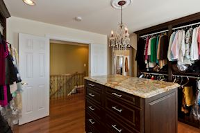 Master Suite Walk-in Closet with Built-ins, Center Island & Feature Chandelier