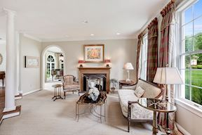 Formal Living Room w Arched Entry into Sun Room