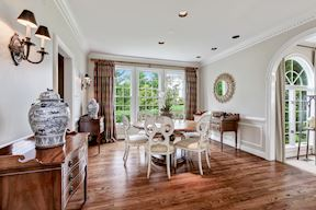 Formal Dining w Arched Opening to Sun Room