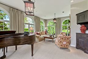 Sun Room w/ Arched Windows & Dual Chandeliers