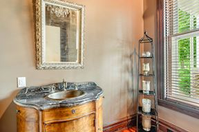 Main Level Powder Room w/ In-Vanity Oulets