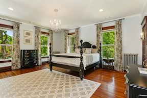 Master Suite w/ His Closet & Overlooking Rear Lawn