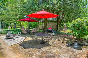 Rear Slate Patio w/ Water-Feature, Dining Area, & Mature Trees