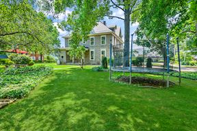 Rear Lawn w/ Extensive Gardens
