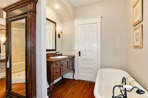 Master Bath Clawfoot Soaking Tub, Armoire, & Separate Vanity
