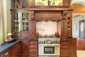 Kitchen w/ 6-Burner Stainless Steel Gas Stove, Pot Filler, & Decorative Tile Backsplash