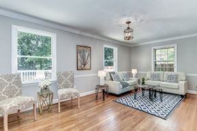 Family Room with Crown Molding and Chair Railing