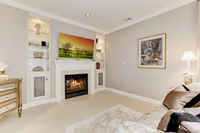Master Sitting Room with Gas Fireplace and Lighted Display Built ins