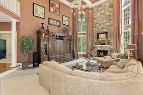 Two-Story Family Room and Stone Fireplace