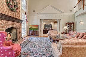 Family Room w/ Cased Opening, Pediment & Column Detail