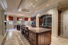 Custom Kitchen w/ Embellished Range Hood  & Back Splash