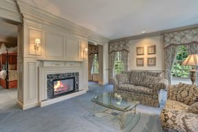 Master Sitting Room w/Built-in Retractable Media Storage Over Mantel